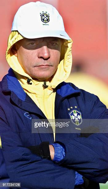 Head coach of the Under20 Brazilian soccer team Carlos Cesar observes dressed for the cold temperatures 18 June 2001 during practice in Cordoba...