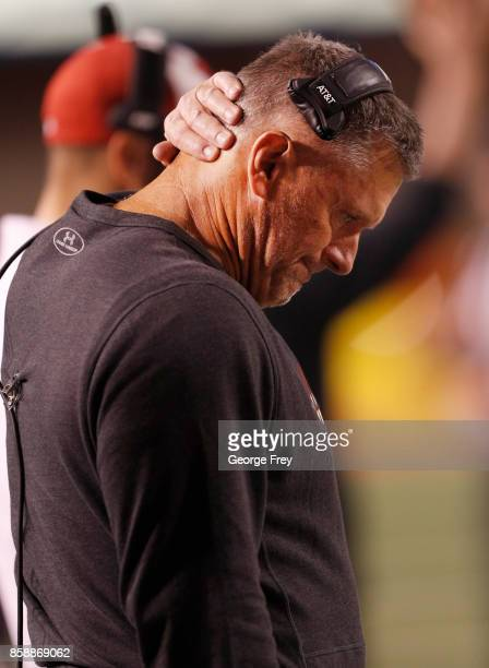 Head coach of the Utah Utes Kyle Whittingham grimaces after a Stanford Cardinal touchdown during the second half of an college football game on...