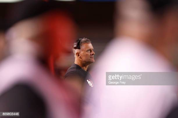 Head coach of the Utah Utes Kyle Whittingham watches from the sidelines during the second half of an college football game against the Stanford...