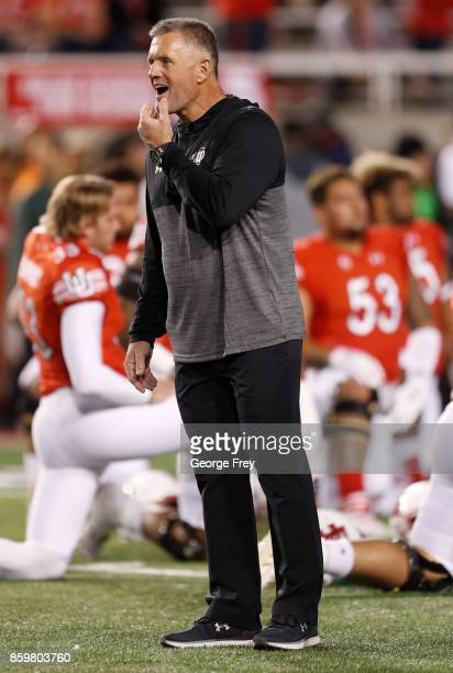 Head coach of the Utah Utes Kyle Whittingham watches warmups before an college football game on October 7 2017 at Rice Eccles Stadium in Salt Lake...