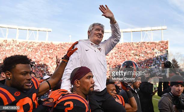 Head coach of the Virginia Tech Hokies Frank Beamer is carried off the field following the game against the North Carolina Tar Heels on November 21...