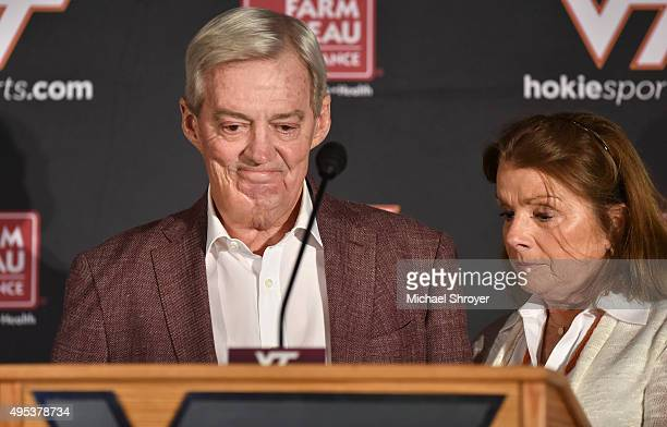 Head coach of the Virginia Tech Hokies Frank Beamer is joined by his wife Cheryl as he announces his retirement in the Merryman Athletic Center on...