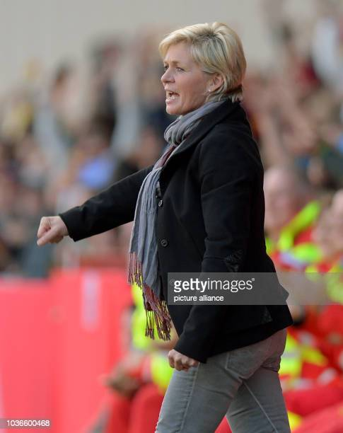 Head coach of the women's national soccer team Silvia Neid cheers during the qualifying match for the FIFA World Cup between Germany and Russia at...