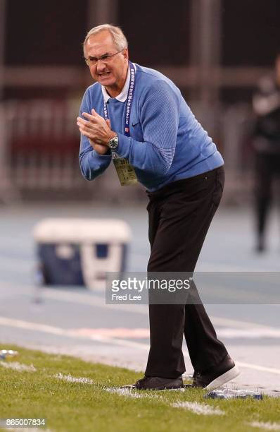 Head coach of Tianjin Elion FC Uli Stielike reacts during the Chinese Super League match between Tianjin Elion FC and Beijing Guoan FC at Tianjin...