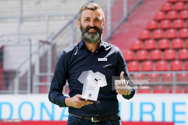 Head coach of TSV 1860 Muenchen Michael Köllner is awarded as head coach of the season prior to the 3. Liga match between FC Ingolstadt 04 and TSV...