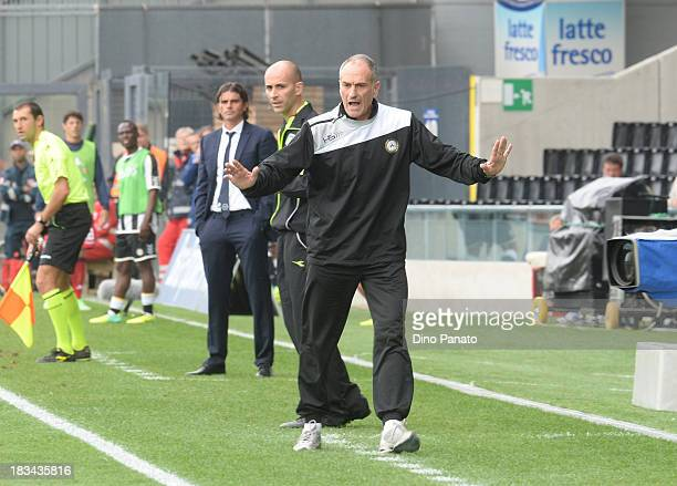 Head coach of Udinese Francesco Guidolin and Head coach of Cagliari Diego Lopez watch from the touchline during the Serie A match between Udinese...
