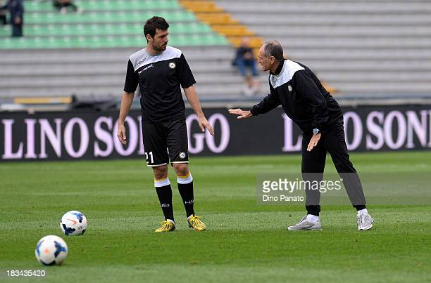 Head coach of Udinese Francesco Guidolin speaks with Andrea Lazzari before between Udinese Calcio and Cagliari Calcio at Stadio Friuli on October 6...