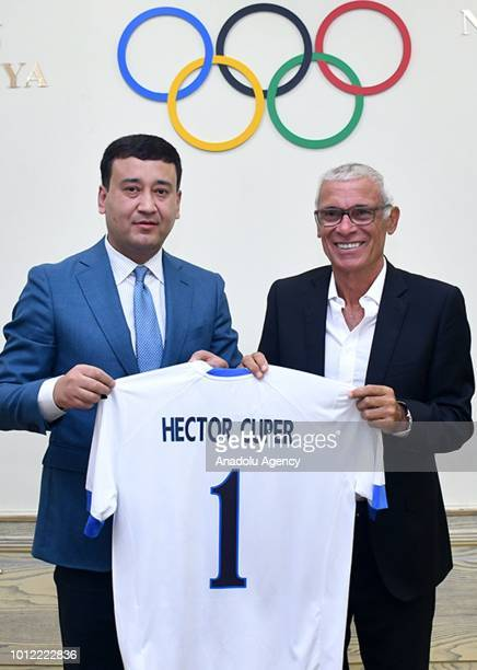 Head coach of Uzbekistan Hector Cuper and VicePresident of the Uzbekistan Football Federation of Umid Ahmadjonov pose for a photo after Cuper's...
