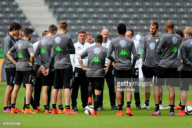 Head coach of VfL Wolfsburg Dieter Hecking talks to his team prior to the DFB Cup Final 2015 training session at Olympiastadion on May 29, 2015 in...