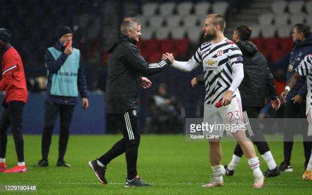 OCTOBER head coach Ole Gunnar Solskjaer of Manchester United celebrate the victory with Luke Shaw after the UEFA Champions League Group H stage match...