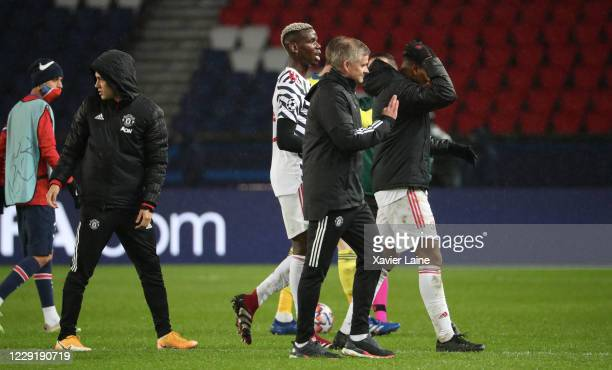 OCTOBER head coach Ole Gunnar Solskjaer of Manchester United celebrate the victory with Paul Pogba after the UEFA Champions League Group H stage...