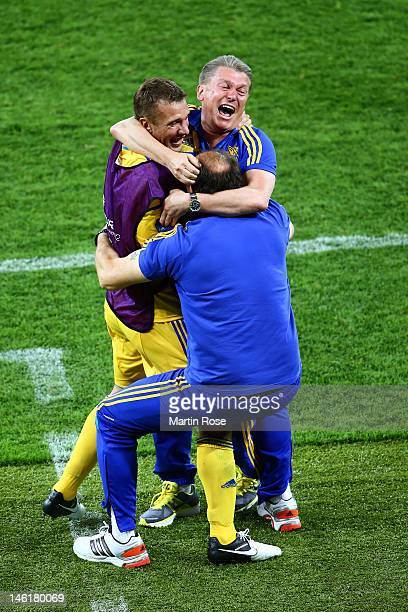 Head Coach Oleh Blokhin of Ukraine celebrates victory Andriy Shevchenko of Ukraine during the UEFA EURO 2012 group D match between Ukraine and Sweden...