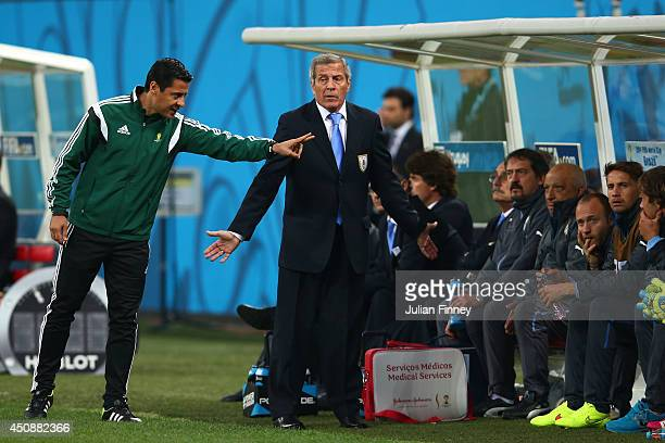 Head coach Oscar Tabarez of Uruguay speaks to fourth official Alireza Faghani during the 2014 FIFA World Cup Brazil Group D match between Uruguay and...