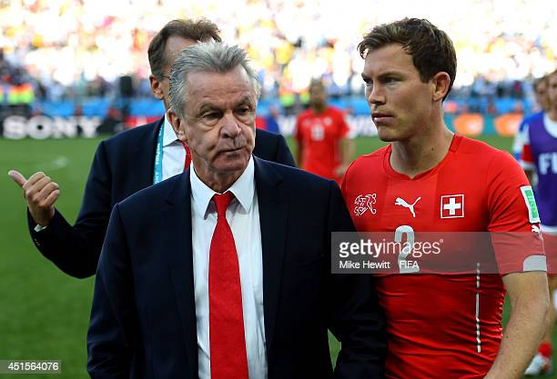 Head coach Ottmar Hitzfeld and Stephan Lichtsteiner of Switzerland walk off the pitch after the 01 defeat in the 2014 FIFA World Cup Brazil Round of...