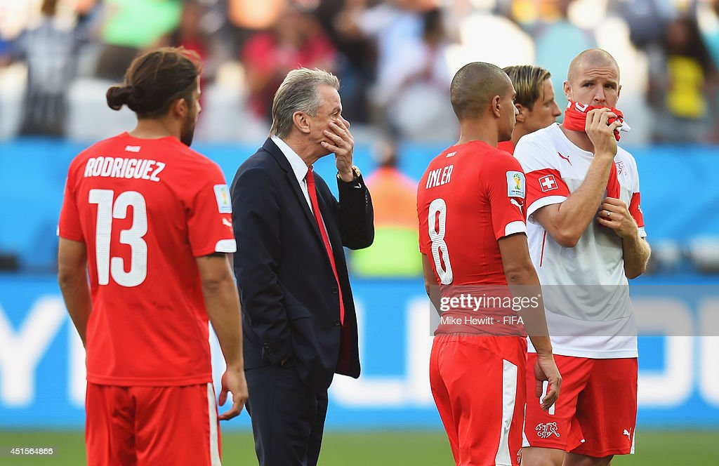 Head coach Ottmar Hitzfeld of Switzerland reacts next to Ricardo Rodriguez of Switzerland (L) and Gokhan Inler of Switzerland after the 0-1 defeat in the 2014 FIFA World Cup Brazil Round of 16 match between Argentina and Switzerland at Arena de Sao Paulo on July 1, 2014 in Sao Paulo, Brazil.