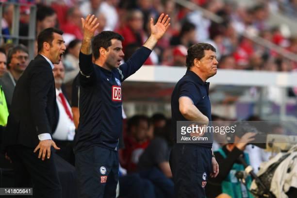 Head coach Otto Rehhagel, assistant coach Rene Tretschok and manager Michael Preetz of Berlin react during the Bundesliga match between FSV Mainz 05...