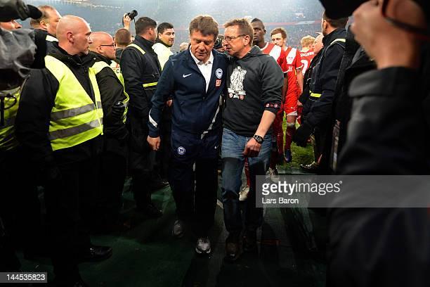Head coach Otto Rehhagel of Berlin hughs head coach Norbert Meier of Duesseldorf during the Bundesliga Relegation second leg match between Fortuna...