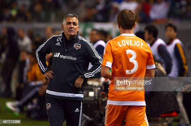 Head Coach Owen Coyle of the Houston Dynamo talks to Rob Lovejoy near the bench area in the first half during the MLS match against the Los Angeles...