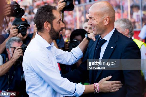 Head Coach Pablo Machin and Head Coach Zinedine Zidane meet ahead of the La Liga match between Girona and Real Madrid at Estadi de Montilivi on...