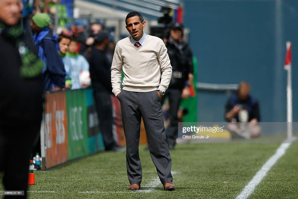 Head coach Pablo Mastroeni of the Colorado Rapids looks on during the match against the Seattle Sounders FC at CenturyLink Field on April 26, 2014 in Seattle, Washington. The Sounders defeated the Rapids 4-1.