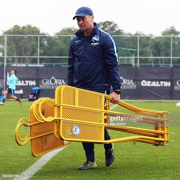 Head coach Pal Dardai carries equipment during a Hertha BSC Berlin training session on day 6 of the Bundesliga Belek training camps at Gloria Sports...