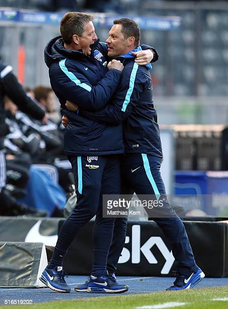 Head coach Pal Dardai of Berlin and assistant coach Rainer Widmayer show their delight after winning the Bundesliga match between Hertha BSC and FC...
