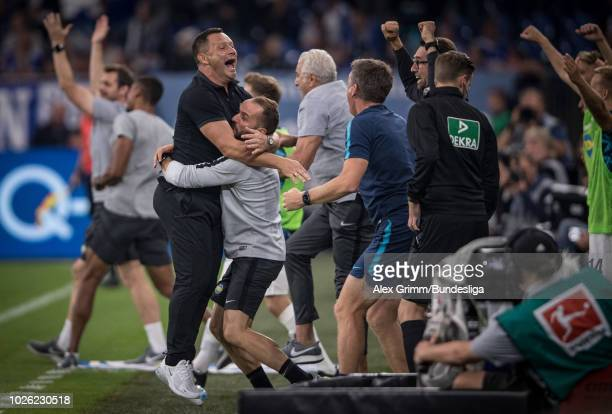 Head coach Pal Dardai of Berlin celebrates after the final whistle of the Bundesliga match between FC Schalke 04 and Hertha BSC at VeltinsArena on...