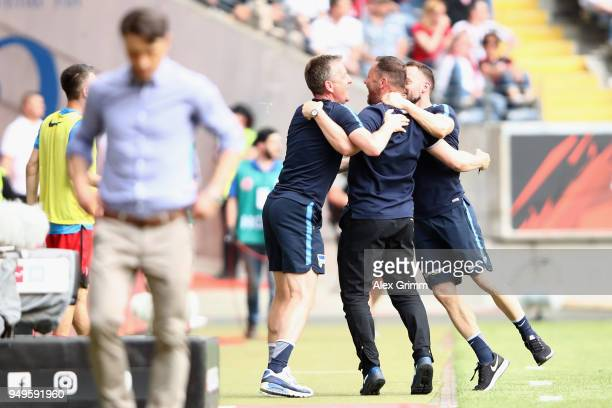 Head coach Pal Dardai of Berlin celebrates with assistant coaches during the Bundesliga match between Eintracht Frankfurt and Hertha BSC at...