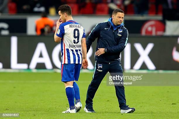 Head coach Pal Dardai of Berlin comforts Alexander Baumjohann of Berlin after the Bundesliga match between Bayer Leverkusen and Hertha BSC Berlin at...