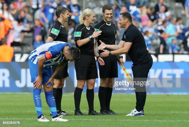Head coach Pal Dardai of Berlin congratulates referee Bibiana Steinhaus after the Bundesliga match between Hertha BSC and SV Werder Bremen at...