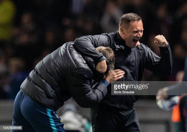 Head coach Pal Dardai of Hertha BSC celebrates with Rainer Widmayer after winning the Bundesliga match between Hertha BSC and FC Bayern Muenchen at...