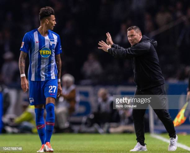 Head coach Pal Dardai of Hertha BSC gives advices to Davie Selke of Hertha BSC during the Bundesliga match between Hertha BSC and FC Bayern Muenchen...