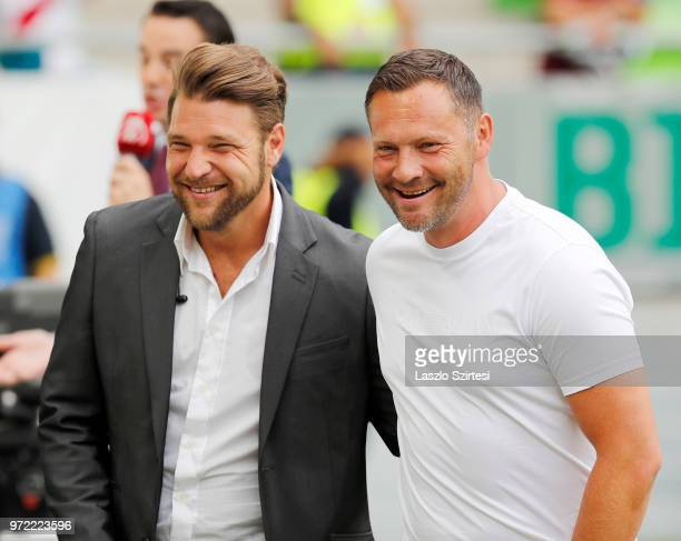 Head coach Pal Dardai of Hertha BSC smiles with former QPR player Akos Buzsaky prior to the International Friendly match between Hungary and...