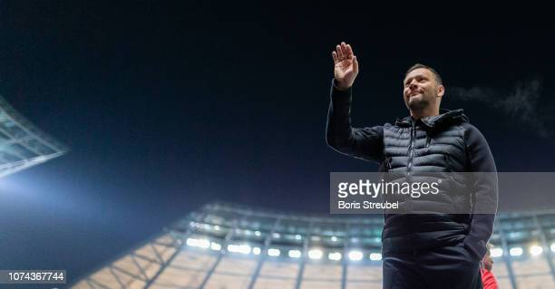 Head coach Pal Dardai of Hertha BSC wave to his fans prior to the Bundesliga match between Hertha BSC and FC Augsburg at Olympiastadion on December...