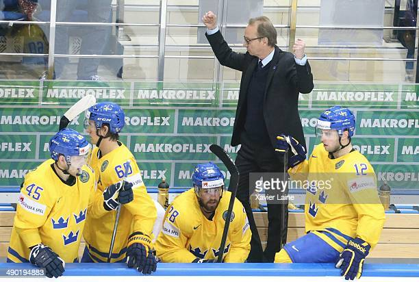 Head coach Par Marts of Sweden celebrate the victory after the 2014 IIHF World Championship between Sweden and Norway at Chizhovka arena on May 13,...