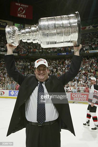 Head coach Pat Burns of the New Jersey Devils holds up the Stanley Cup after defeating the Mighty Ducks of Anaheim 30 in game seven of the 2003...