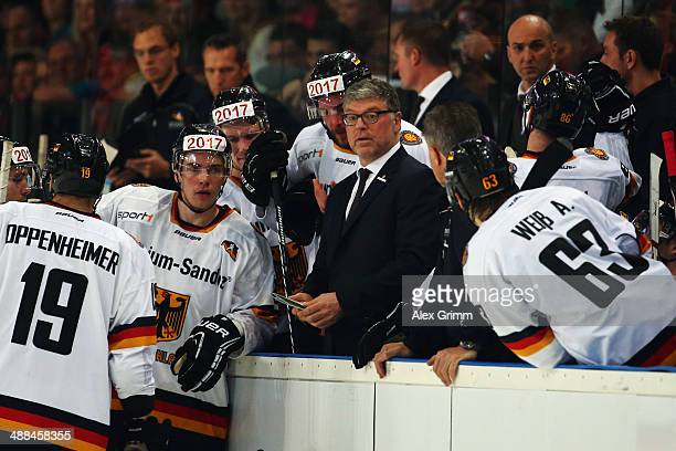 Head coach Pat Cortina of Germany talks to the players during the international ice hockey friendly match between Germany and USA at Arena...