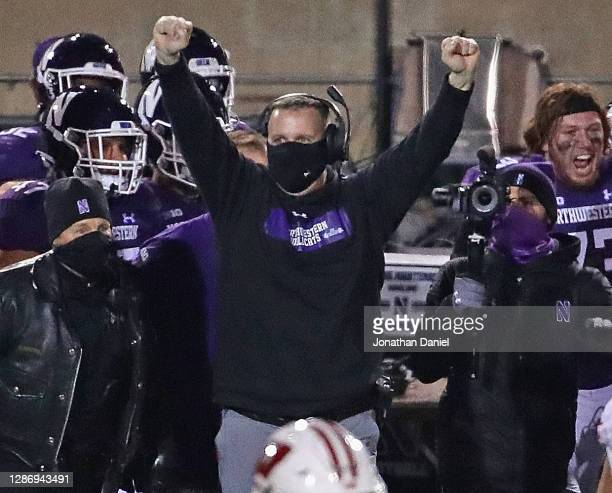 Head coach Pat Fitzgerald of the Northwestern Wildcats celebrates a win in the closing seconds against the Wisconsin Badgers at Ryan Field on...