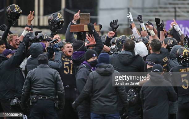 """Head coach Pat Fitzgerald of the Northwestern Wildcats holds the """"Land of Lincoln"""" trophy, awarded each year to the winning team between Northwestern..."""