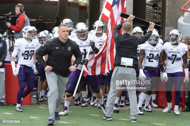 Head coach Pat Fitzgerald of the Northwestern Wildcats leads the team on the field before the game against the Nebraska Cornhuskers at Memorial...