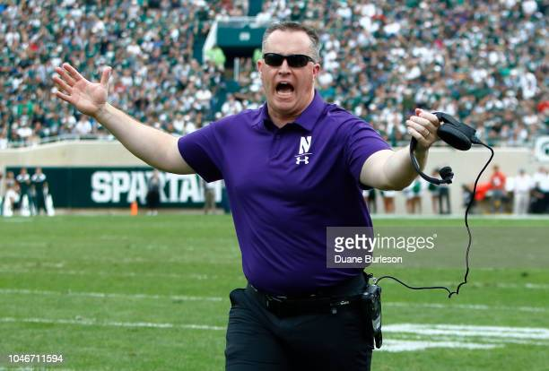 Head coach Pat Fitzgerald of the Northwestern Wildcats reacts after quarterback Brian Lewerke of the Michigan State Spartans was sacked and no safety...