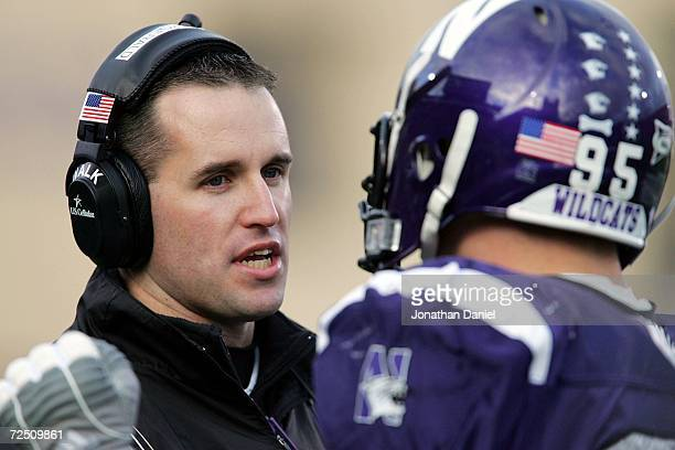 Head coach Pat Fitzgerald of the Northwestern Wildcats talks to Kevin Mims on the sidelines during a game against the Ohio State Buckeyes on November...