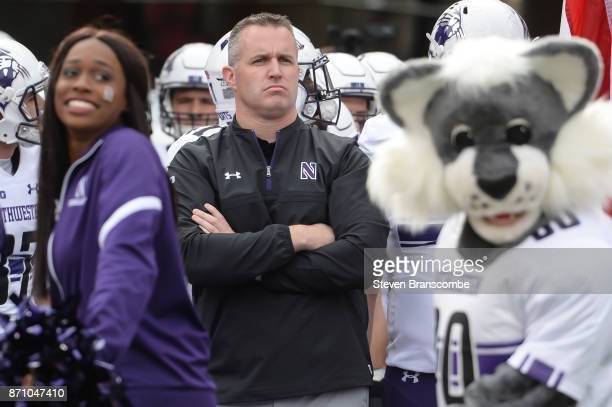 Head coach Pat Fitzgerald of the Northwestern Wildcats waits to run on the field before the game against the Nebraska Cornhuskers at Memorial Stadium...