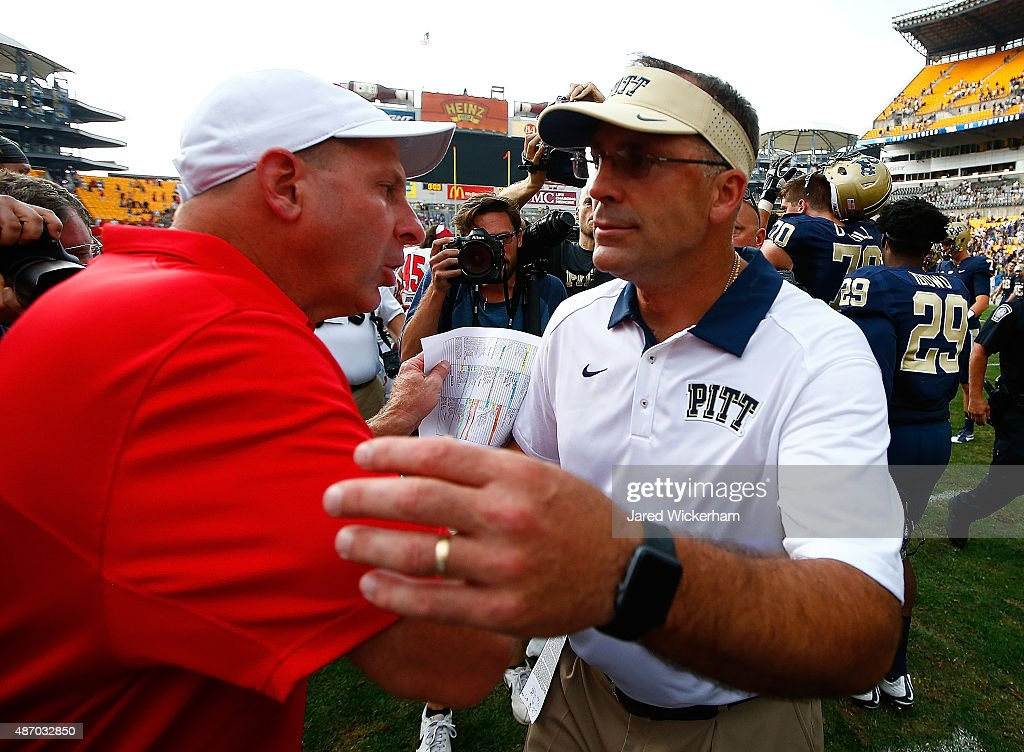 Head coach Pat Narduzzi of the Pittsburgh Panthers and head coach Bo Pelini of the Youngstown State Penguins shake hands following the game at Heinz Field on September 5, 2015 in Pittsburgh, Pennsylvania.