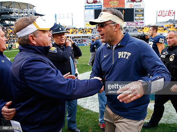Head coach Pat Narduzzi of the Pittsburgh Panthers shakes hands with head coach Brian Kelly of the Notre Dame Fighting Irish following the game at...