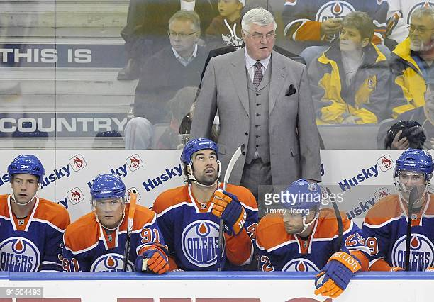 Head coach Pat Quinn and his Edmonton Oilers sit on the bench in a game between the Calgary Flames and the Edmonton Oilers in an NHL game on October...