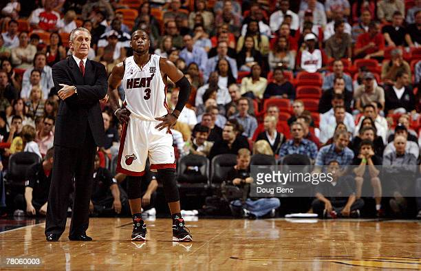 Head coach Pat Riley and Dwyane Wade of the Miami Heat talk during free throws while taking on the Atlanta Hawks at American Airlines Arena on...