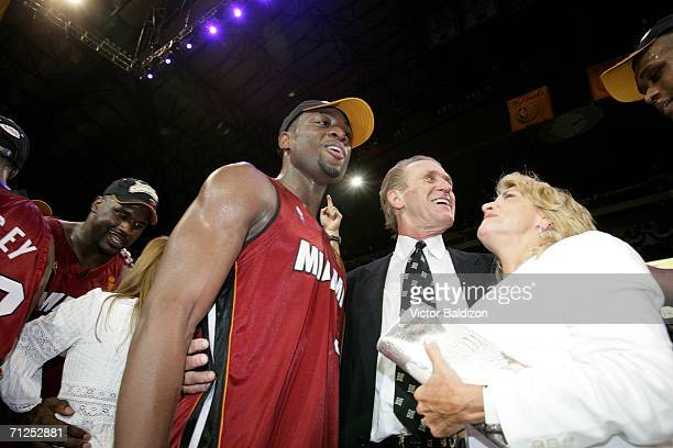 Head coach Pat Riley and Finals MVP Dwyane Wade of the Miami Heat and Riley's wife Chris Riley celebrate winning the NBA Championship after the Heat...