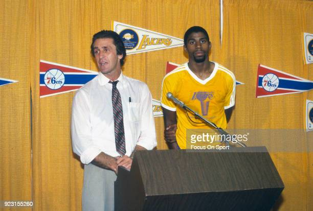 Head Coach Pat Riley and Magic Johnson of the Los Angeles Lakers talks to the media after an NBA basketball game circa 1982 at The Forum in Inglewood...