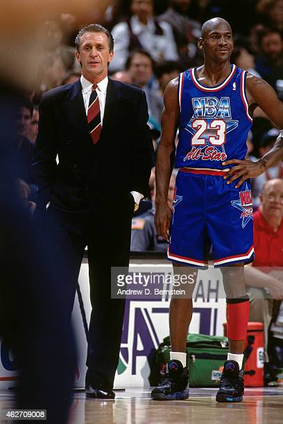 Head Coach Pat Riley and Michael Jordan of the Eastern Conference AllStars looks on against the Western Conference AllStars during the 1993 AllStar...